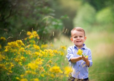 Family photography session in Barnsley with a boy holding yellow flowers