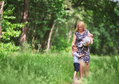 Barnsley family photography session, mum with son and baby cuddling