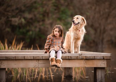 Family photographer in Barnsley, little girl by the lake with her dog