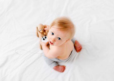 Baby paying with natural at at Barnsley baby photography session
