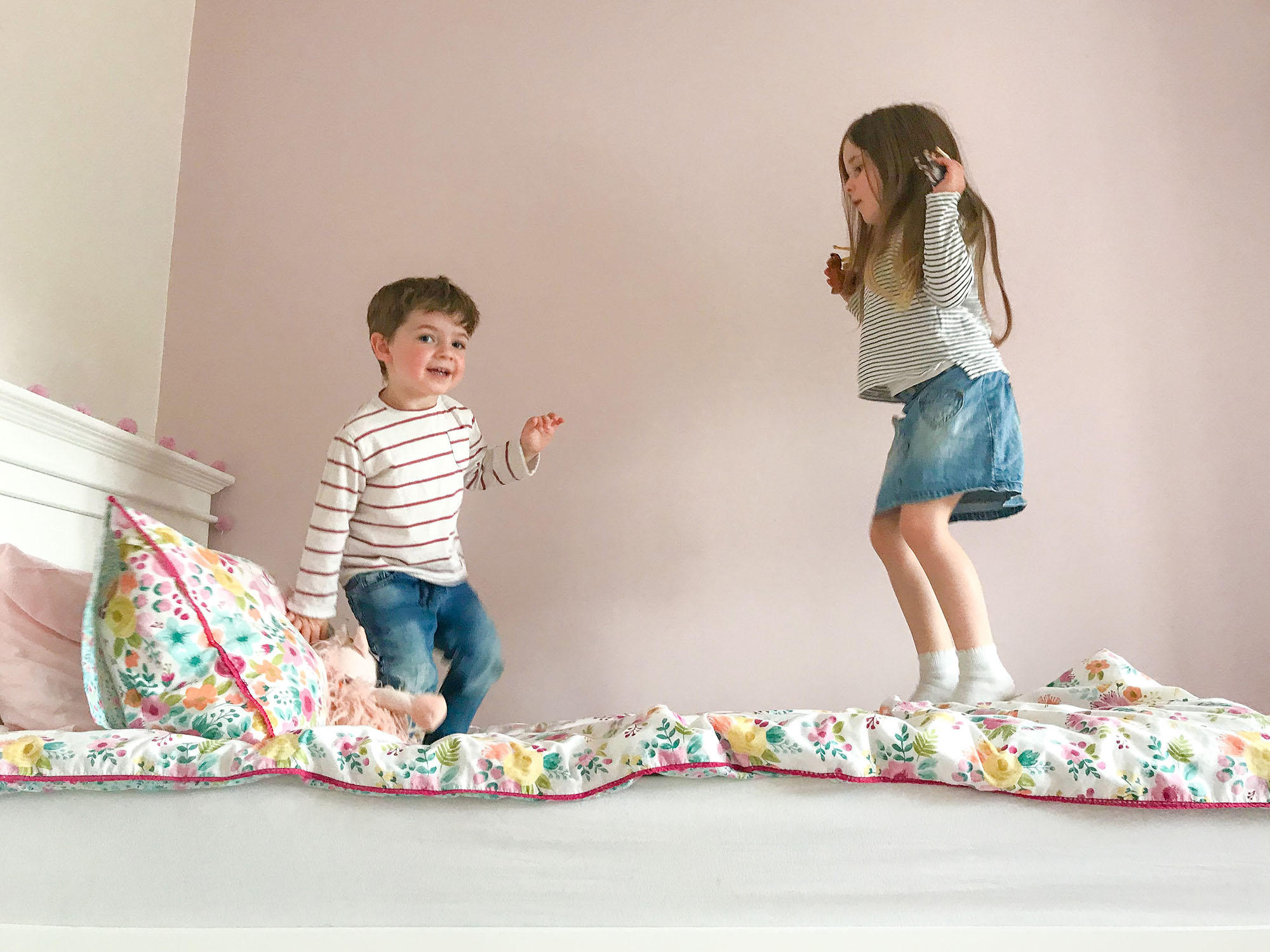 Taking professional photos with your phone, jumping on the bed