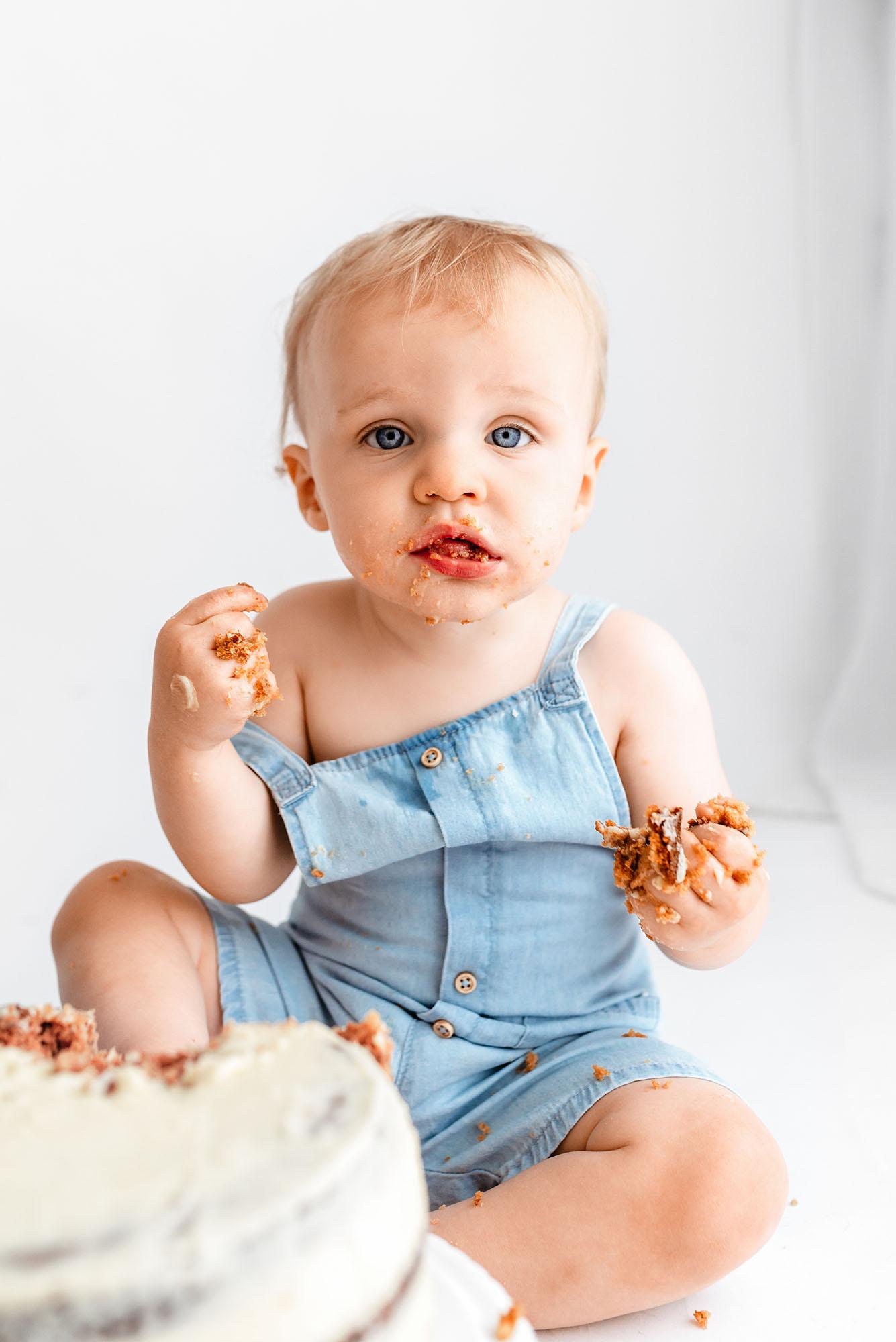 Cake Smash Photography Sheffield, luther eating cake