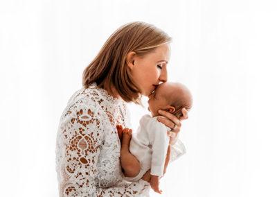 Mum kissing baby at Barnsley Newborn Photographer studio