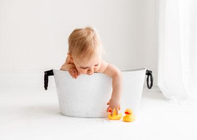 Bath tub fun at photography cake smash session in Barnsley