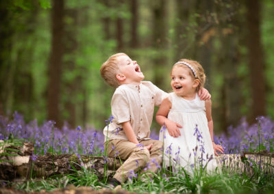 children laughing at a bluebell photoshoot with Barnsley family photographer