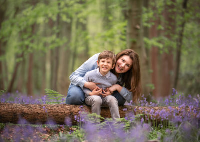 mum and son laughing in bluebells at Barnsley family photography session