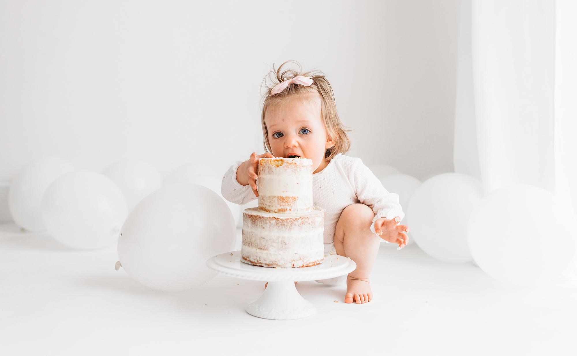 Cake Smash Photographer Barnsley with baby diving into cake