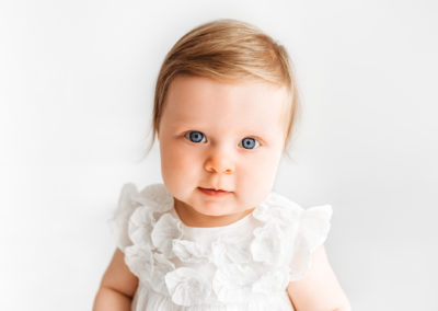 Baby looking straight into camera with her blue eyes with Barnsley baby photographer