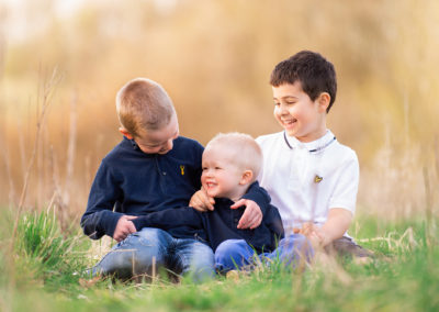 family photographer in Barnsley, siblings enjoying a cuddle