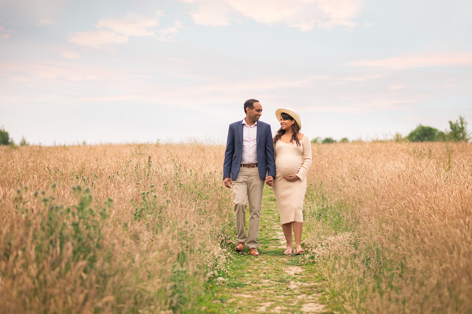 maternity photographer, couple walking towards the camera